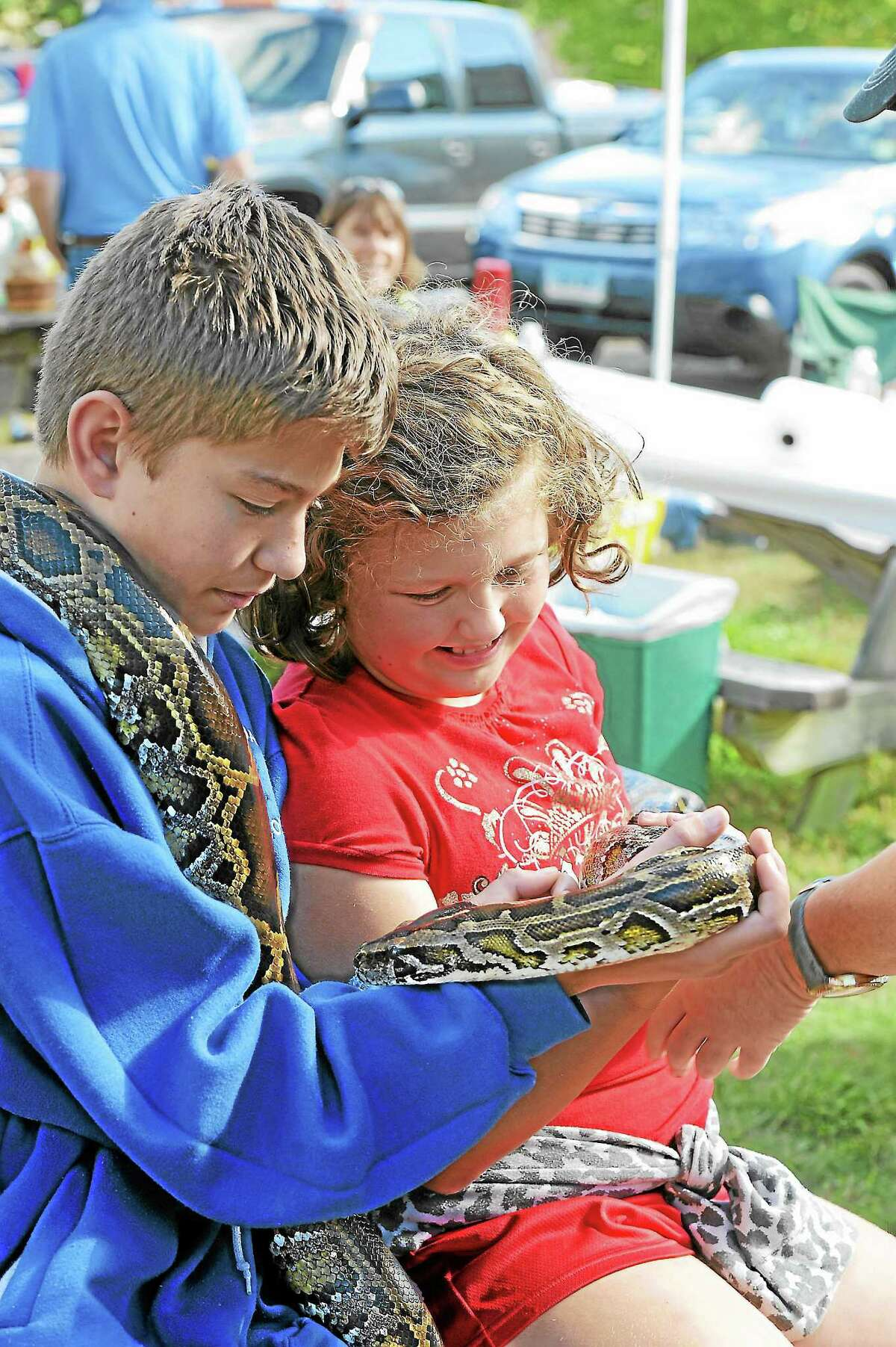 Brooke & Mitchel Kvedar of Burlington with a boa constrictor at the 32nd annual Family Nature Day at White Memorial Conservation Center in Litchfield.Laurie Gabaordi - Register Citizen
