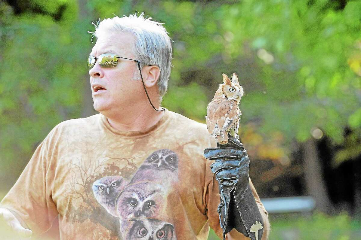 Brian Bradley (Sky Hunters in Flight) holding an African Whiteface Owl at the 32nd annual Family Nature Day at White Memorial Conservation Center in Litchfield.Laurie Gabaordi - Register Citizen