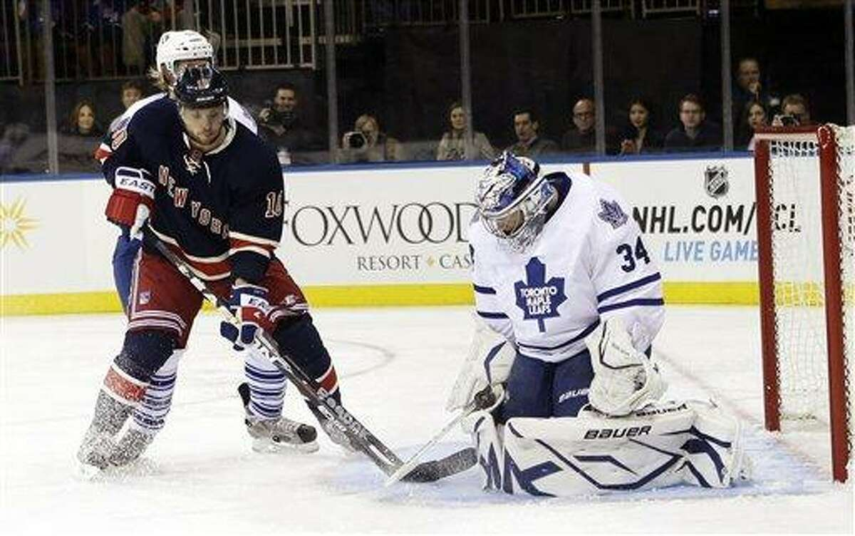 Toronto Maple Leafs goalie James Reimer (34) stops a shot on goal by New York Rangers' Marian Gaborik (10) during the second period of an NHL hockey game, Saturday, Jan. 26, 2013, in New York. (AP Photo/Frank Franklin II)