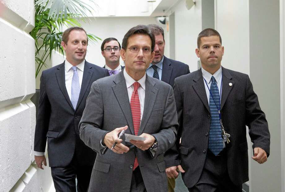 House Majority Leader Eric Cantor of Va., walks out of a Republican caucus at the U.S. Capitol in Washington, Saturday, Sept. 28, 2013.  Lawmakers from both parties urged one another in a rare weekend session to give ground in their fight over preventing a federal shutdown, with the midnight Monday deadline fast approaching. Photo: Molly Riley — The Associated Press  / FR170882 AP