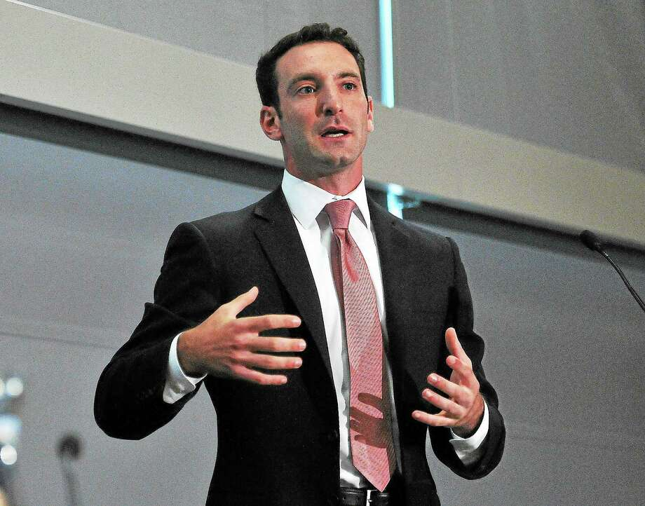 """Zachary Cooper, assistant professor of public health and economics at Yale, speaks during the """"Ready To Launch"""" conference discussing the Affordable Care Act and U.S. health policy Friday. Photo: Peter Casolino — New Haven Register"""