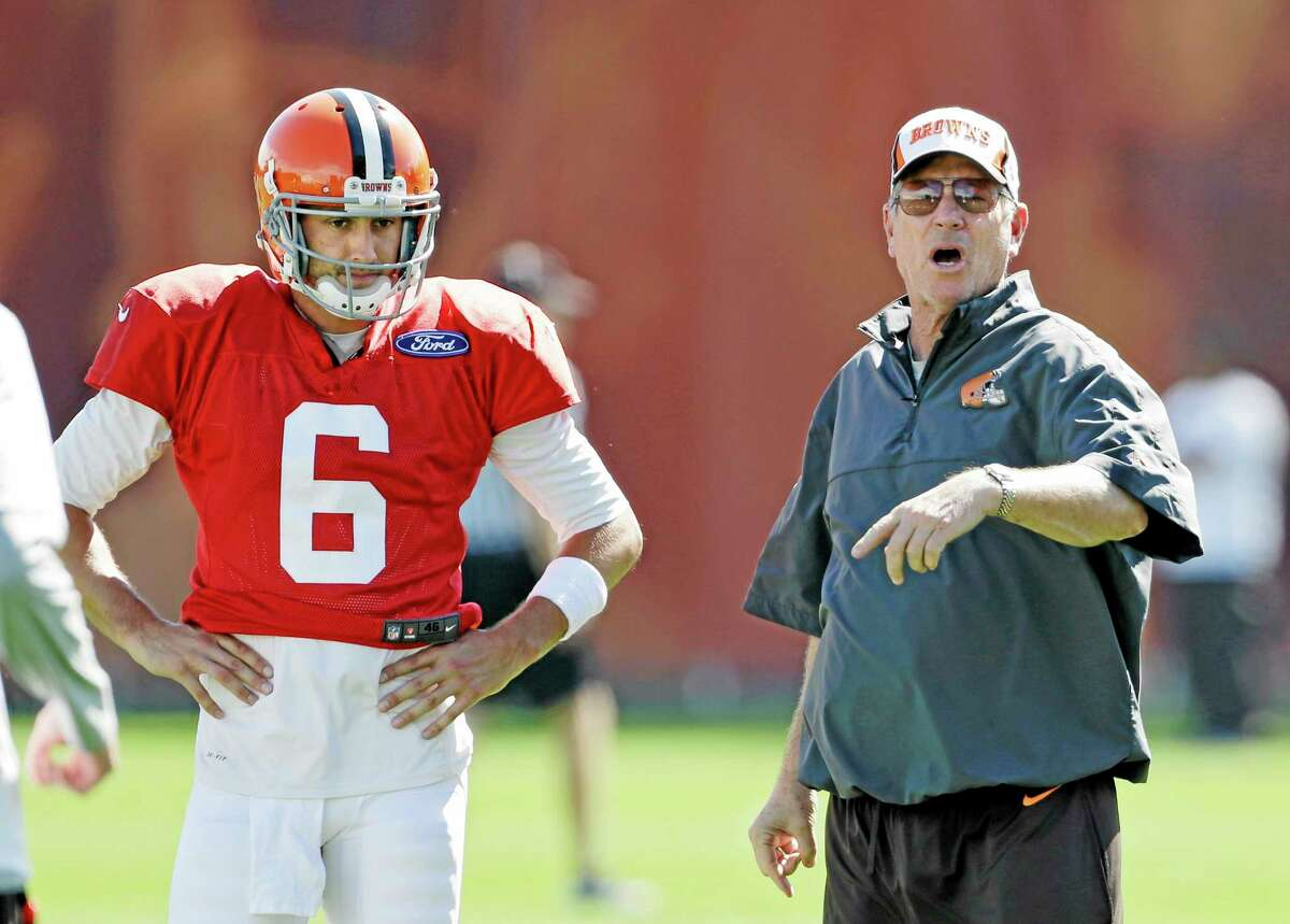 Cleveland Browns offensive coordinator Norv Turner instructs the offense as quarterback Brian Hoyer looks on during Wednesday's practice at the team's facility in Berea, Ohio. Head coach Rob Chudzinski said Hoyer will start again Sunday against the Cincinnati Bengals in place of injured Brandon Weeden, who is still recovering from a sprained right thumb and isn't ready to play.