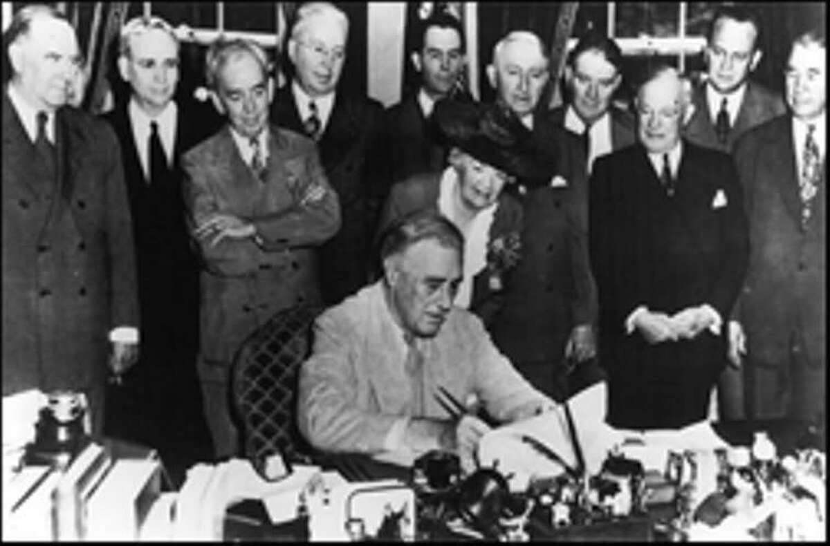 President Franklin D. Roosevelt signs the GI Bill of Rights.