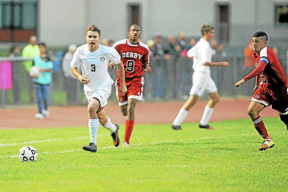 Laurie Gaboardi Register CitizenNick Mancini dribbles through Derby defenders. Mancini added one goal in Torrington's 7-0 win against Derby. Photo: Journal Register Co.