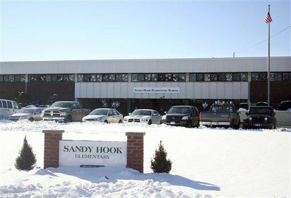 This photo provided by the Monroe Police Department shows the new Sandy Hook Elementary School on the first day of classes in Monroe, Conn., Thursday, Jan. 3, 2013. The school, formerly known as Chalk Hill School, was overhauled especially for the students from the Sandy Hook School shooting in Newtown, in the neighboring town of Monroe, Conn. (AP Photo/Monroe Police Department)