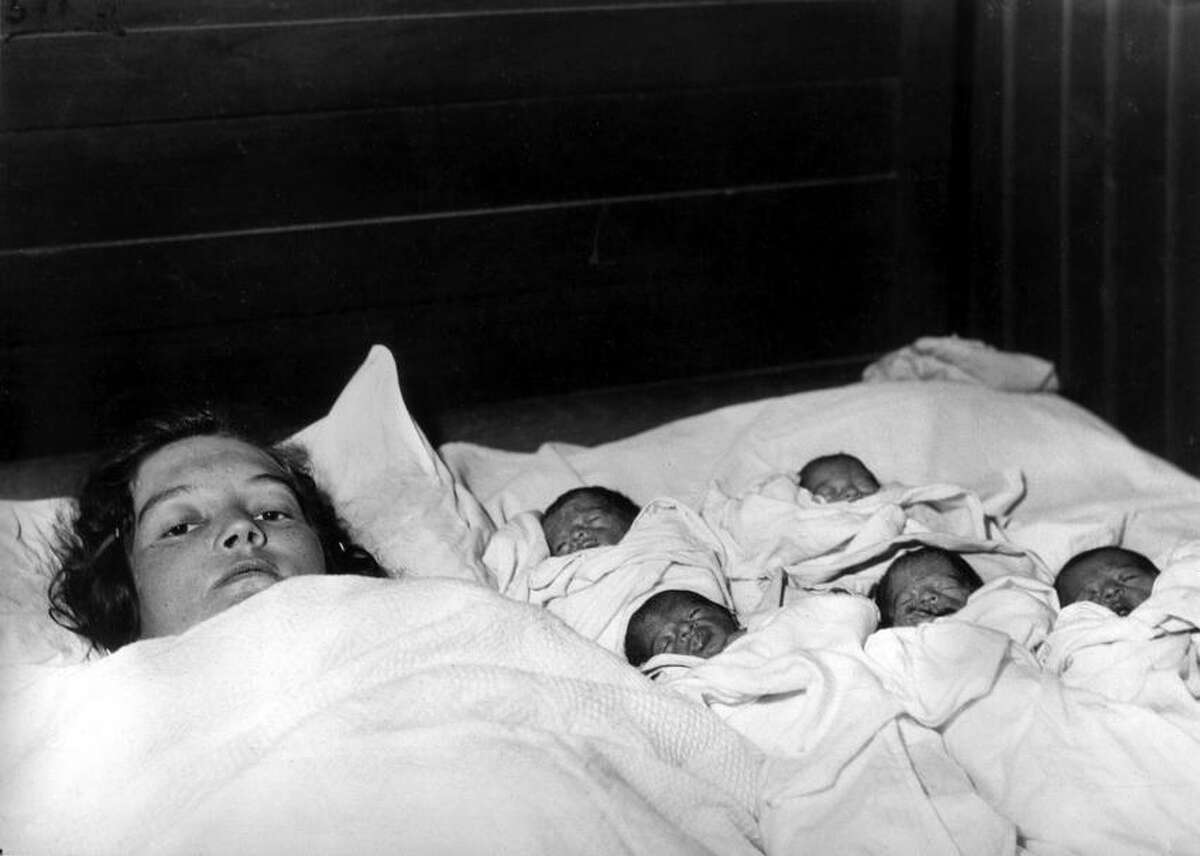 Elzire Dionne is shown with her five girls shortly after their birth in Corbeil, near Callander in northern Ontario, Canada, on May 28, 1934. The identical quintuplets, born at least two months premature, are the first known quintupletes to survive infancy. (AP Photo)