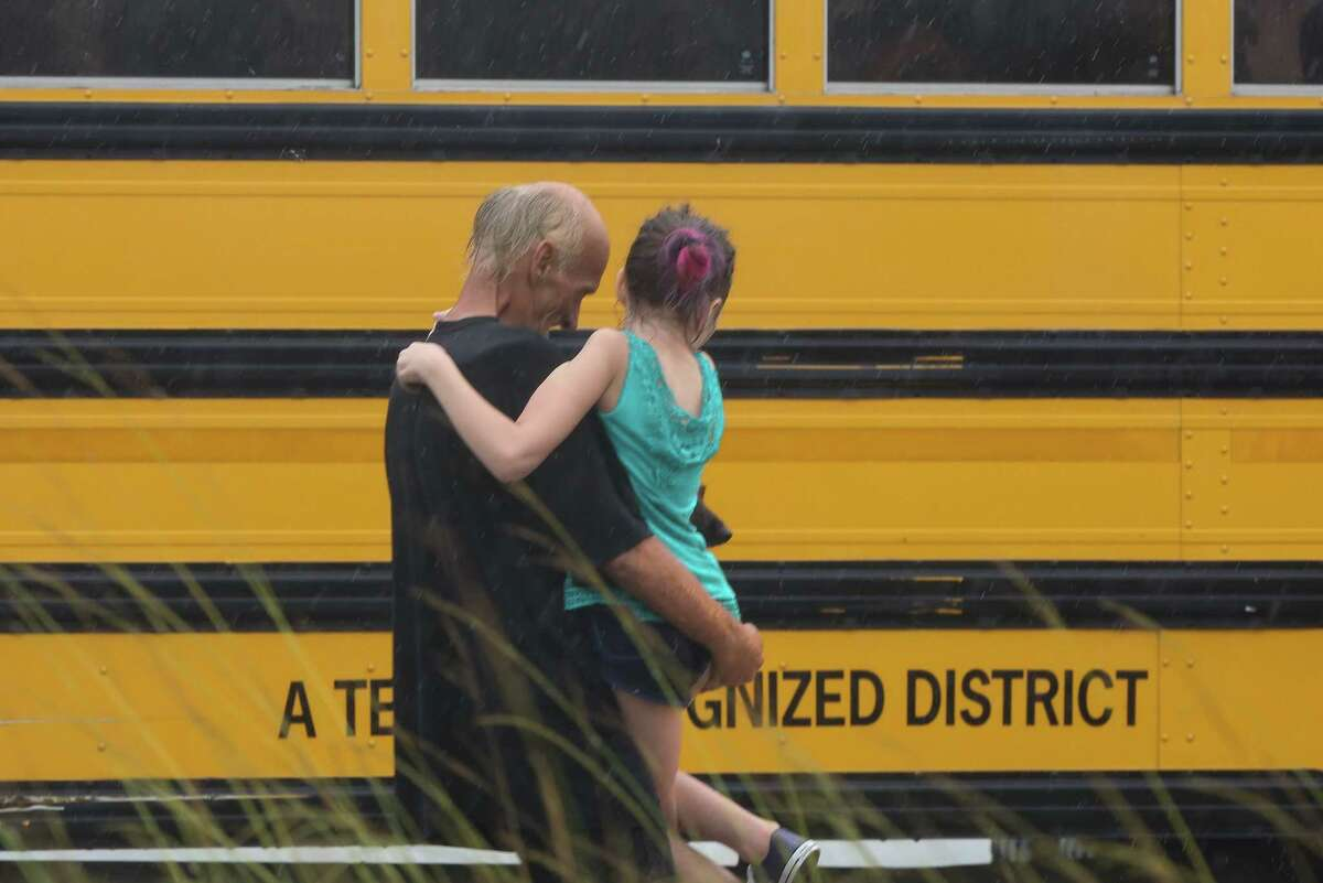 After being rescued by a boat, Dickinson evacuees from the flooded area are boarding on a bus to be transferred to the Gulf Greyhound Park in La Marque at Interstate 45 northbound and Hughes Road overpass on Sunday, August 27, 2017, in Dickinson.