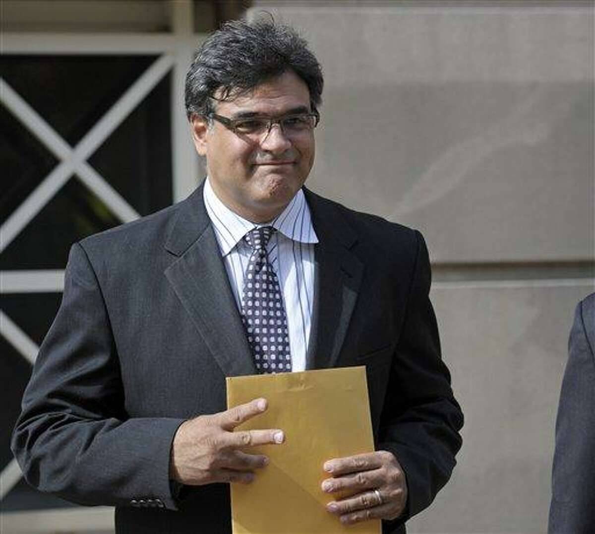 Former CIA officer John Kiriakou leaves U.S. District Courthouse in Alexandria, Va., in October 2012. Kiriakou was sentenced Friday to more than two years in prison by a federal judge who rejected arguments that he was acting as a whistleblower when he leaked a covert officer's name to a reporter. Associated Press file photo