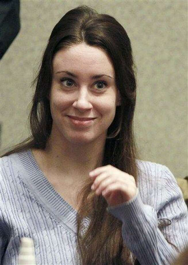 FILE - In this July 7, 2011 file photo, Casey Anthony smiles before the start of her sentencing hearing in Orlando, Fla.  A state appellate court is being asked to decide Tuesday Jan. 8, 2013 whether the Florida mother was in police custody when she made the statements that led to her being convicted of lying to law enforcement officers.  (AP Photo/Joe Burbank, File) Photo: AP / Pool Orlando Sentinel