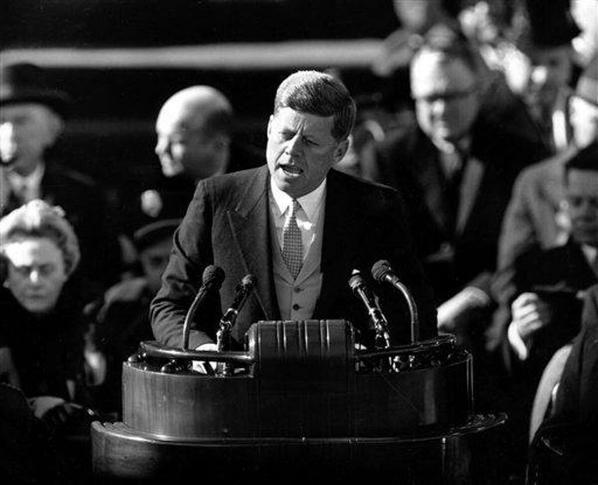 FILE - This Jan. 20, 1961 black-and-white file photo shows President John F. Kennedy delivering his inaugural address after taking the oath of office, on Capitol Hill in Washington. Sixteen presidents before Barack Obama got a second chance at giving an inaugural address for the ages. Most didn't make much of it. Abraham Lincoln is the grand exception. (AP Photo, File)