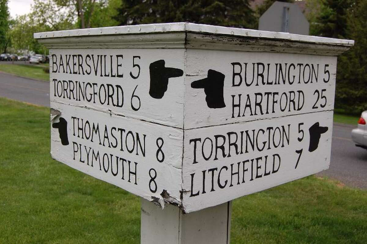 Register Citizen File Photo - The historic Harwinton sign post as seen before repairs were made in May.