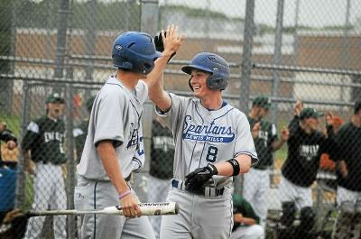Photo by Sean Meenaghan/Register Citizen Lewis Mills' Kyle Eisenmann congratulates Sam Brooke as he crosses the plate against Enfield.
