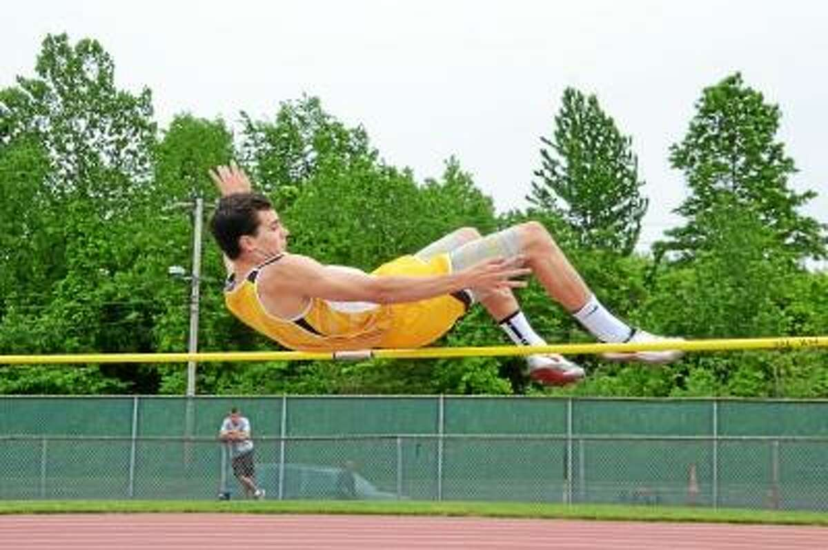 Pete Paguaga/Register Citizen Thomaston's Alex Gagne competes in the high jump at the Class S State Championship Meet.