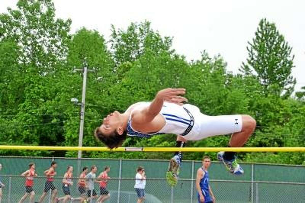 Photo by Pete Paguaga Litchfield's Spencer Persechino attempts the high jump at the CIAC Class S state tournament.