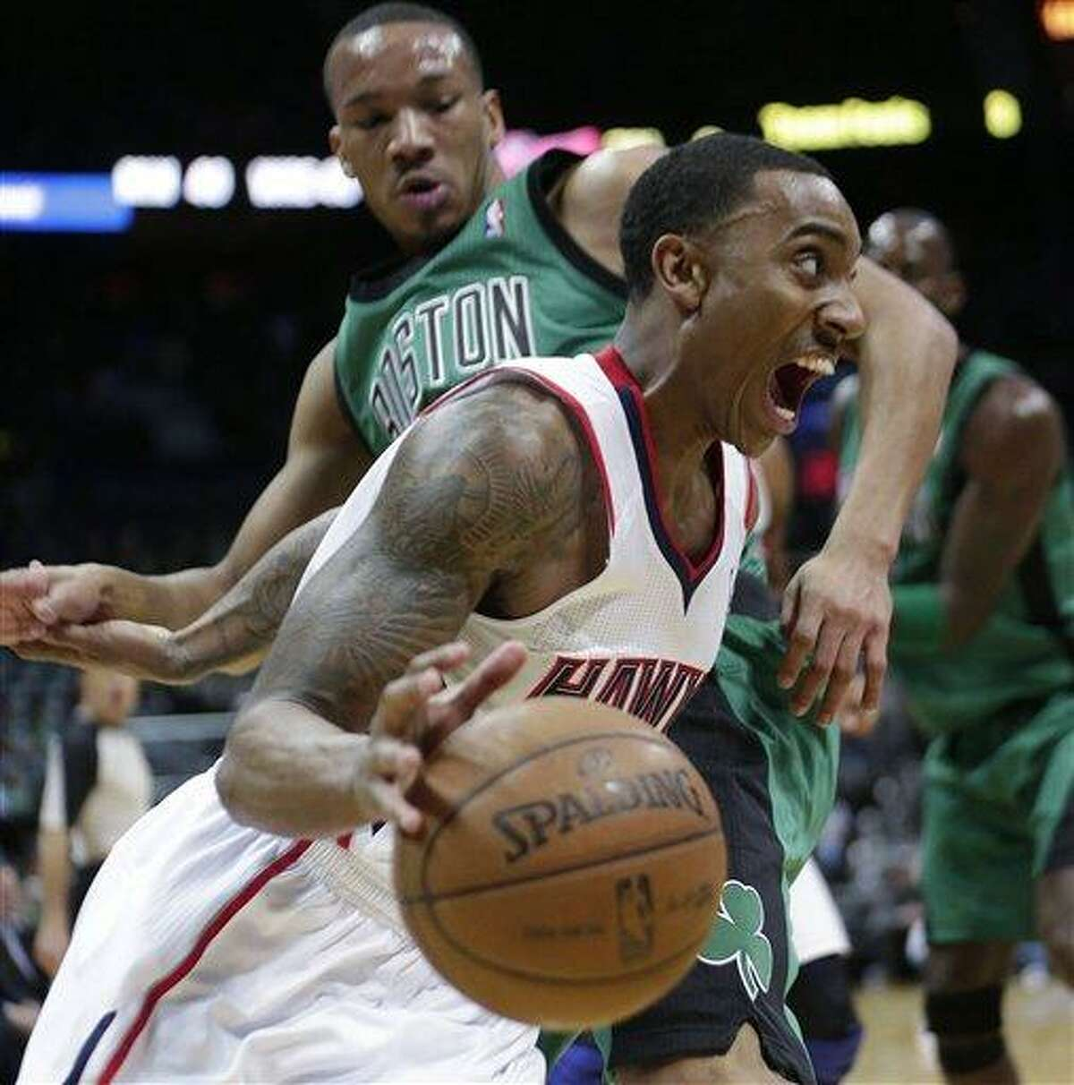 Atlanta Hawks guard Jeff Teague drives against Boston Celtics guard Avery Bradley during the first half of an NBA basketball game Friday, Jan. 25, 2013, in Atlanta. (AP Photo/John Bazemore)
