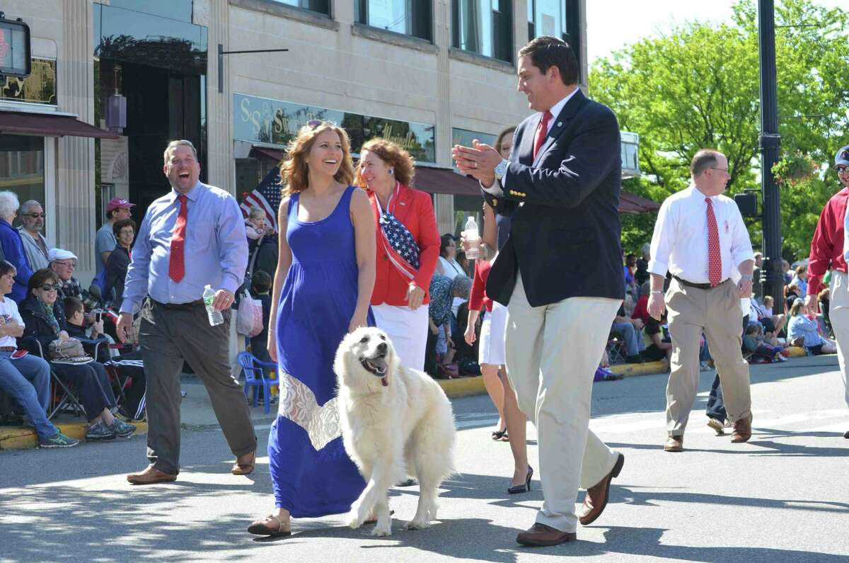 Mayor Ryan Bingham walks with his wife, Jen, and their dog in the Torrington Memorial Day parade Monday. (Tom Caprood/Register Citizen)