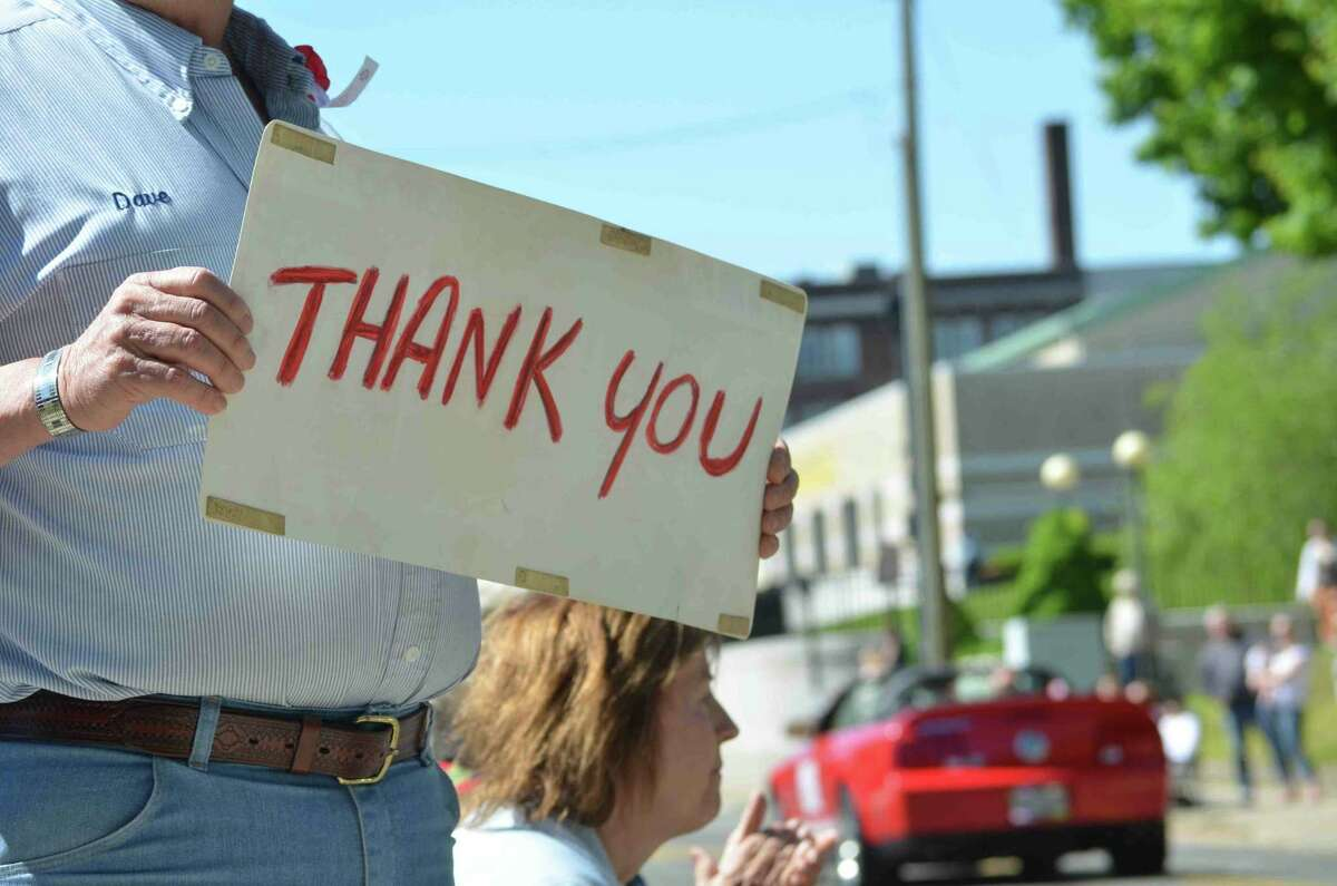 A man holds a simple 'Thank You' sign during Torrington's Memorial Day parade Monday.(Tom Caprood/Register Citizen)