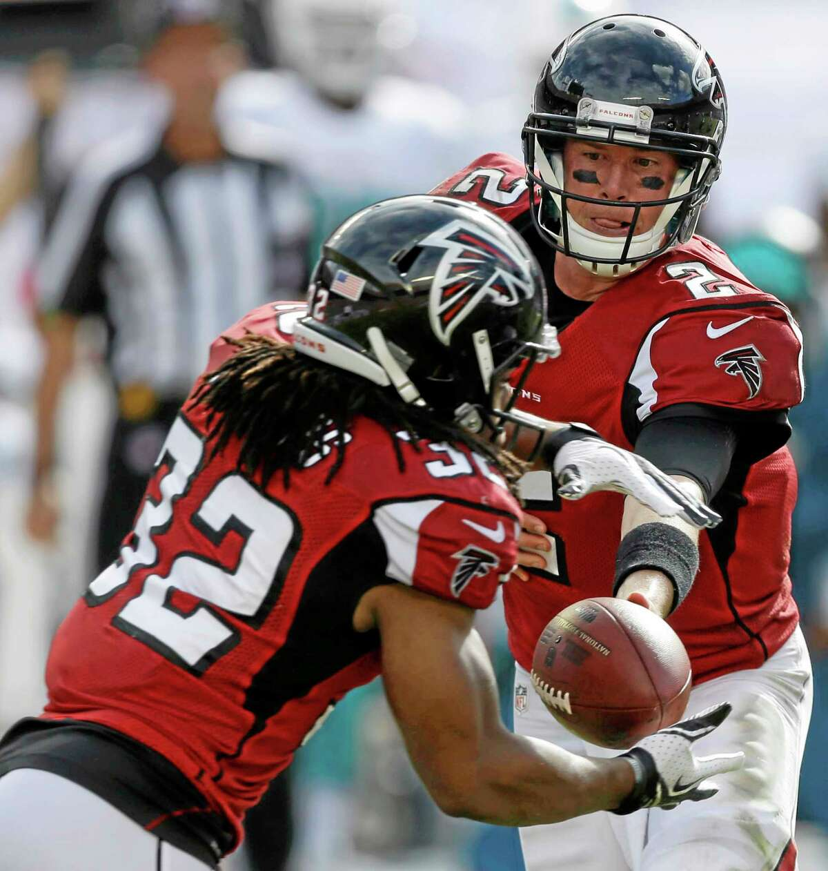 Atlanta Falcons quarterback Matt Ryan, right, hands the ball to running back Jacquizz Rodgers during the first half of Sunday's loss to the Miami Dolphins in Miami Gardens, Fla.