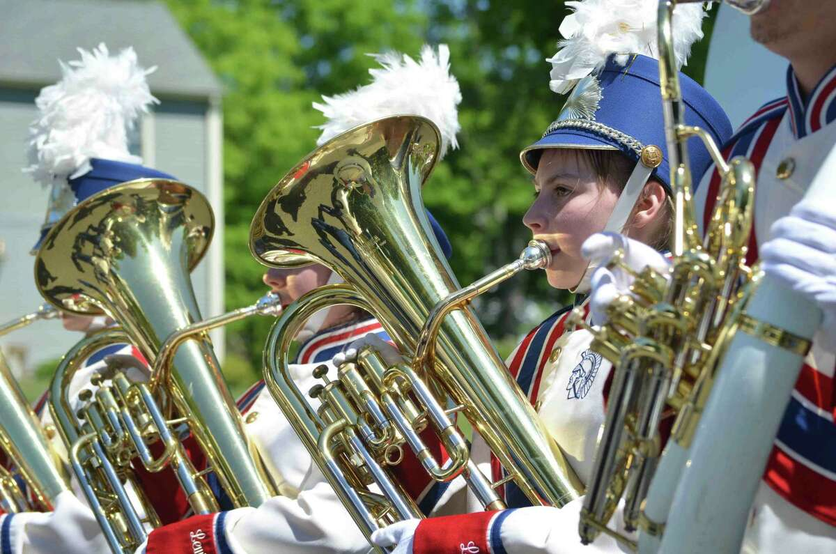 Tom Caprood/Register Citizen - Members of the Lewis Mills High School Marching Band performed during the Harwinton Memorial Day Parade on Monday, May 27.