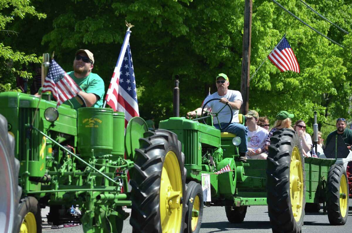 Tom Caprood/Register Citizen - A line of tractors traveled through the Harwinton Memorial Day Parade on Monday, May 27.