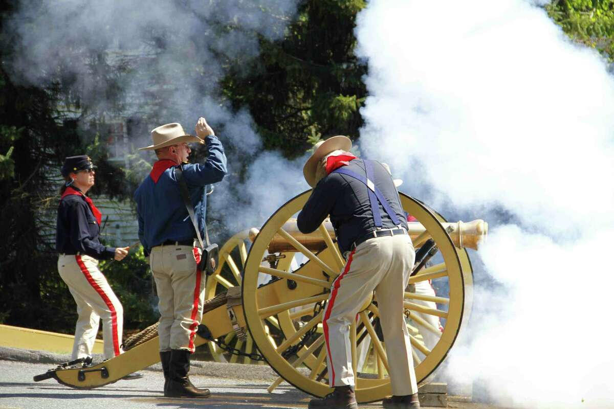 Esteban L. Hernandez/Register Citizen - A canon is fired by members of the First Litchfield Artillery Regiment during Harwinton's Memorial Day Parade on Monday, May 27.