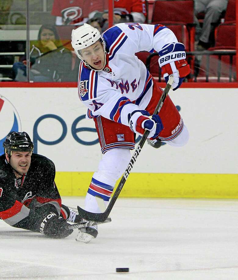 The New York Rangers' Derek Stepan is back in the fold with the Rangers, agreeing to a two-year contract that should have him back on the ice in time for the season opener. A contract was finally worked out Thursday, one week before the Rangers start the regular season at Phoenix. Photo: Gerry Broome — The Associated Press  / AP