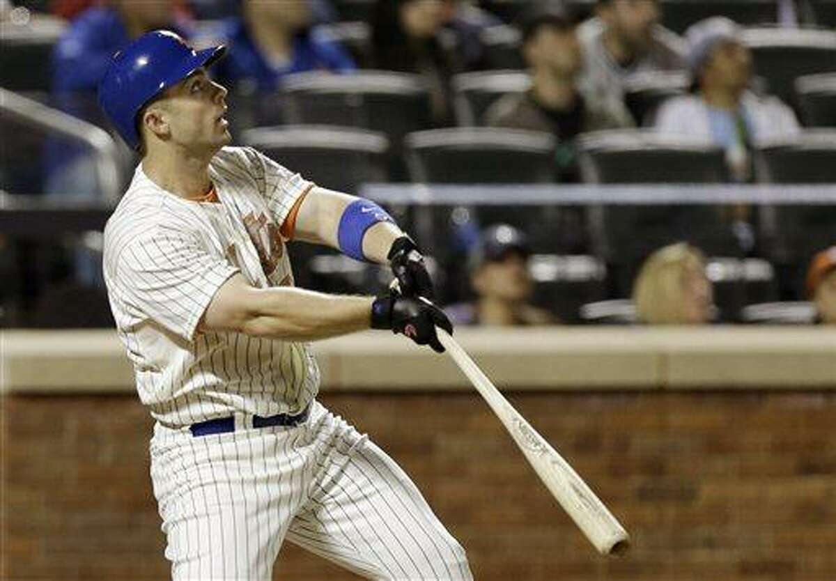 New York Mets David Wright (5) hits a seventh-inning, game-tying home run off New York Yankees starting pitcher Phil Hughes in an interleague baseball game at Citi Field in New York, Monday, May 27, 2013. (AP Photo/Kathy Willens)