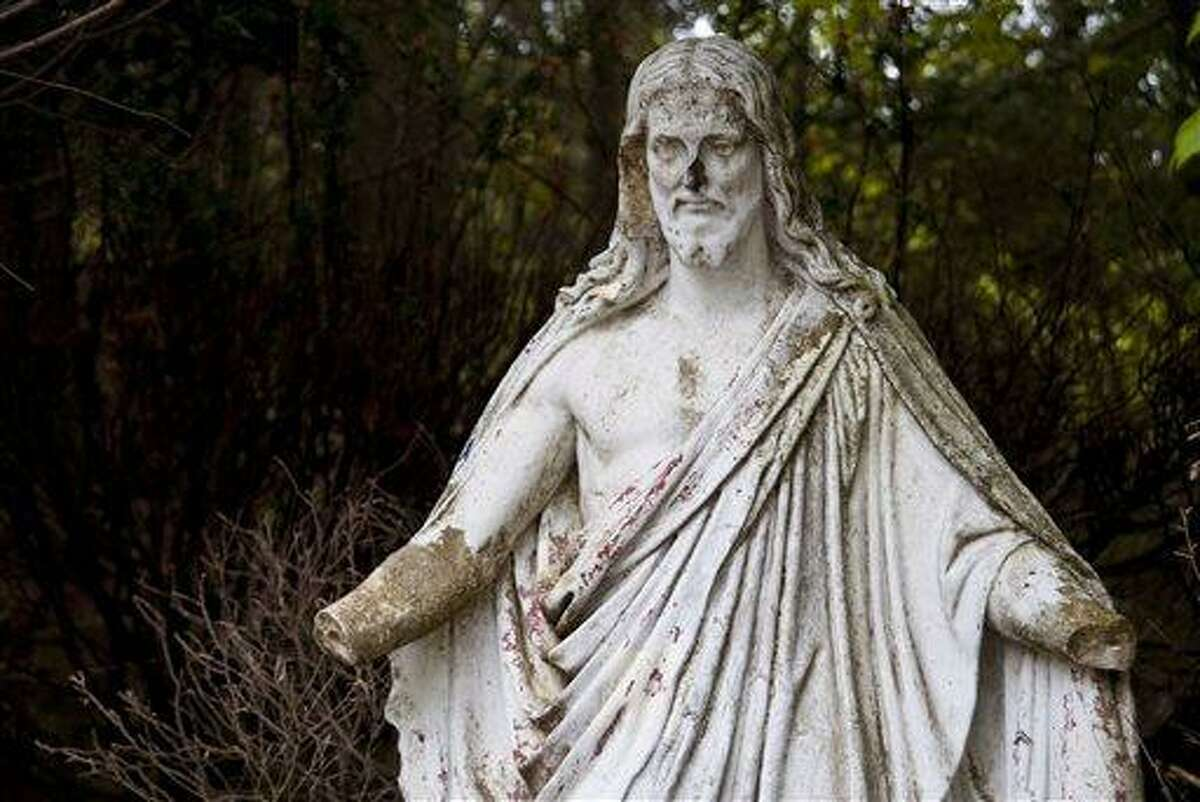 This May 18, 2013 photo, shows a broken statue in Holy Land U.S.A. in Waterbury, Conn. Two years after the property that was once the Holy Land U.S.A. theme park in Waterbury was put up for sale, the rocky crags adorned with the crumbling makeshift models of biblical scenes still haven't attracted a buyer. (AP Photo/The Republican-American, Jim Shannon)