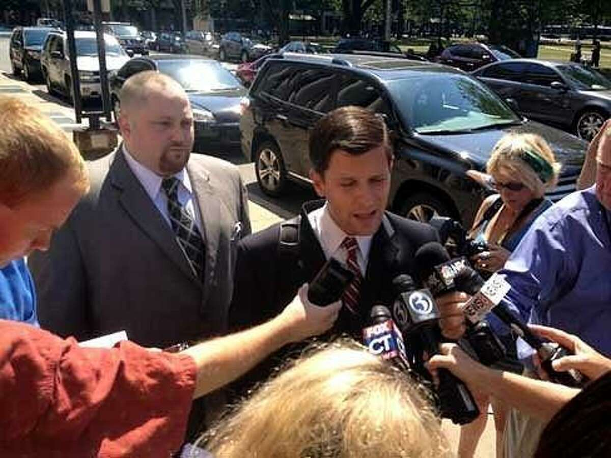 Robert Braddock Jr. stands behind his attorney, Frank Riccio, last summer outside the courthouse in New Haven. Christine Stuart/CT News Junkie file photo