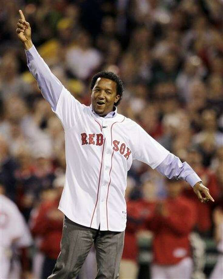 FILE - In this April 4, 2010, file photo, former Boston Red Sox pitcher Pedro Martinez reacts after throwing the ceremonial first pitch before the Red Sox opening game of the baseball season against the New York Yankees in Boston. Martinez, a three-time Cy Young Award winner and eight-time All-Star, who spent seven seasons in Boston, was brought back to the franchise to serve as a special assistant to general manager Ben Cherington, the team announced, Thursday, Jan. 24, 2013. (AP Photo/Charles Krupa, File) Photo: ASSOCIATED PRESS / A2010