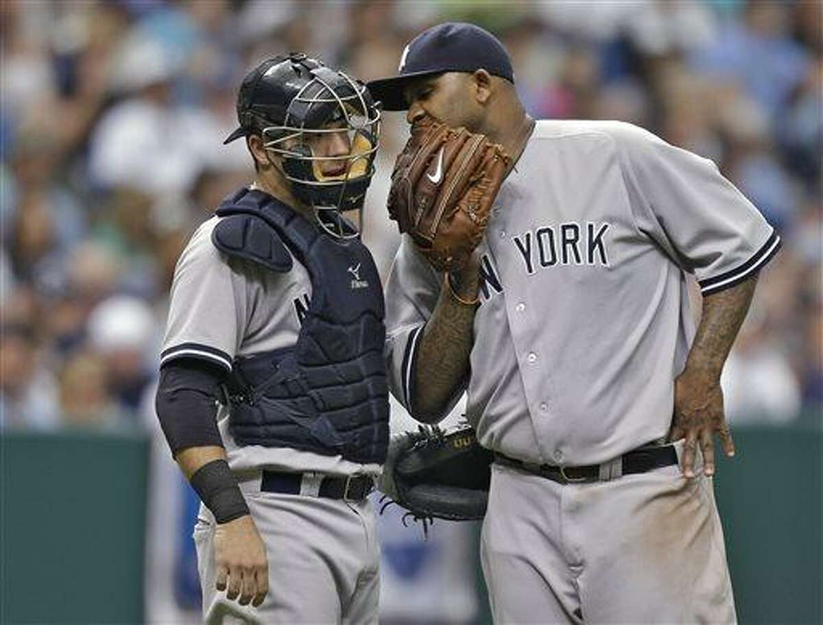 New York Yankees starting pitcher CC Sabathia, right, talks to catcher Austin Romine as he struggles during the sixth inning of a during a baseball game against the Tampa Bay Rays Sunday, May 26, 2013, in St. Petersburg, Fla. (AP Photo/Chris O'Meara)