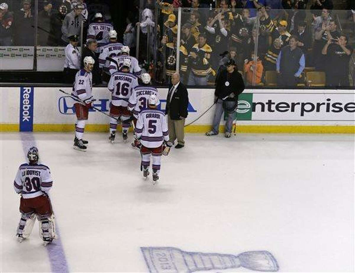 New York Rangers skate off the ice after being eliminated from the playoffs by the Boston Bruins after a 3-1 loss in Game 5 of the Eastern Conference semifinals in the NHL hockey Stanley Cup playoffs in Boston, Saturday, May 25, 2013. (AP Photo/Charles Krupa)