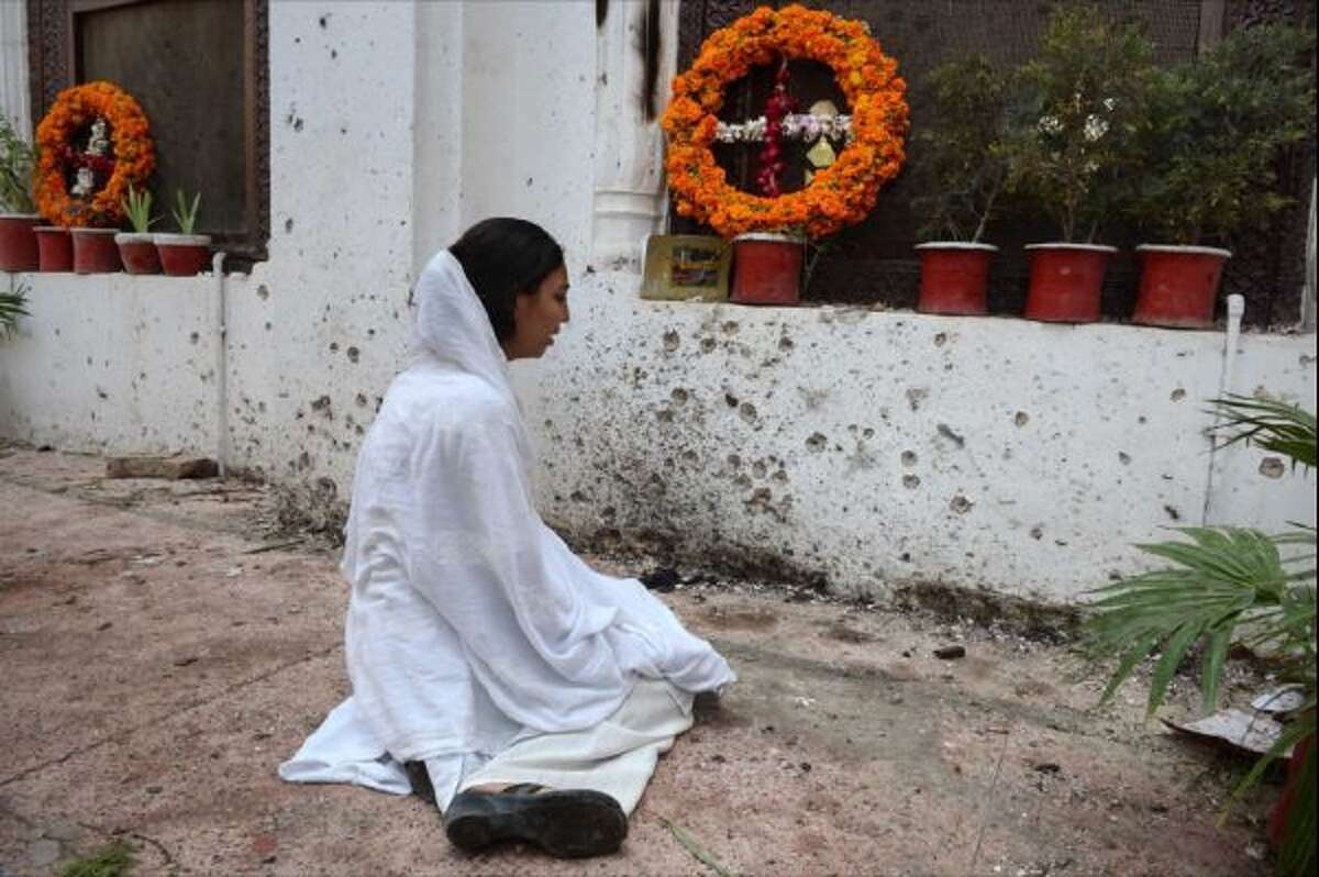 A Pakistani Christian woman mourns the death of a relative killed in a suicide bombing near damage at the All Saints church in Peshawar on Sept. 24.