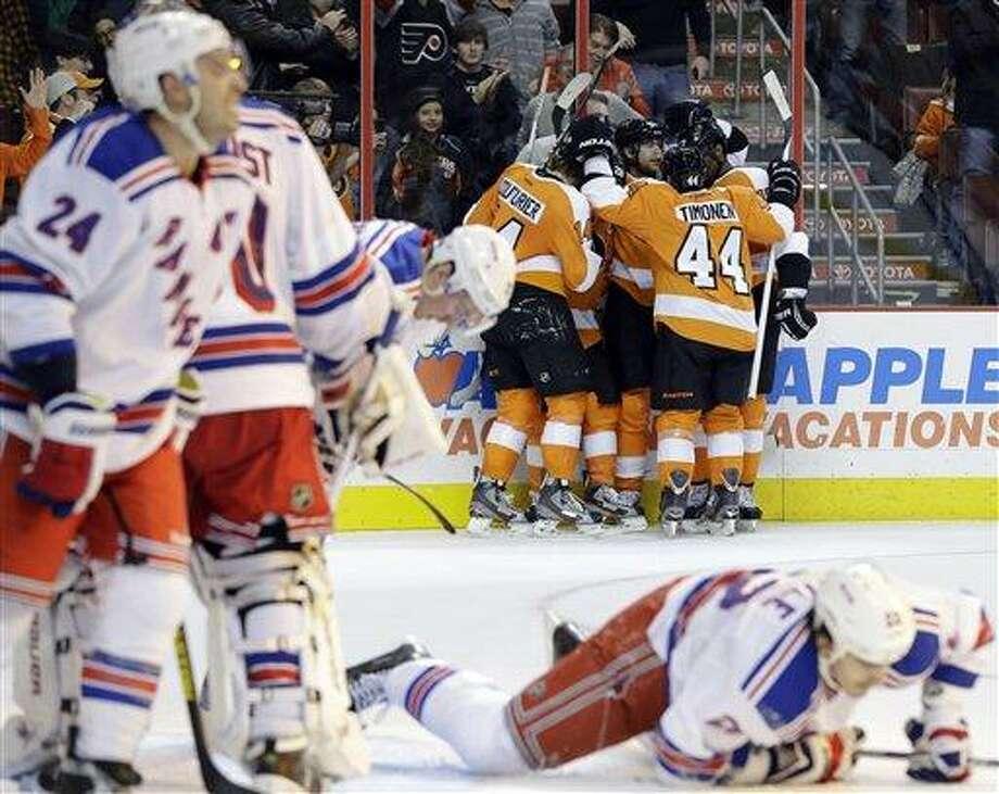 Philadelphia Flyers players celebrate after a goal by Jakub Voracek, of the Czech Republic, during the second period of an NHL hockey game against the New York Rangers, Thursday, Jan. 24, 2013, in Philadelphia. (AP Photo/Matt Slocum) Photo: ASSOCIATED PRESS / AP2013