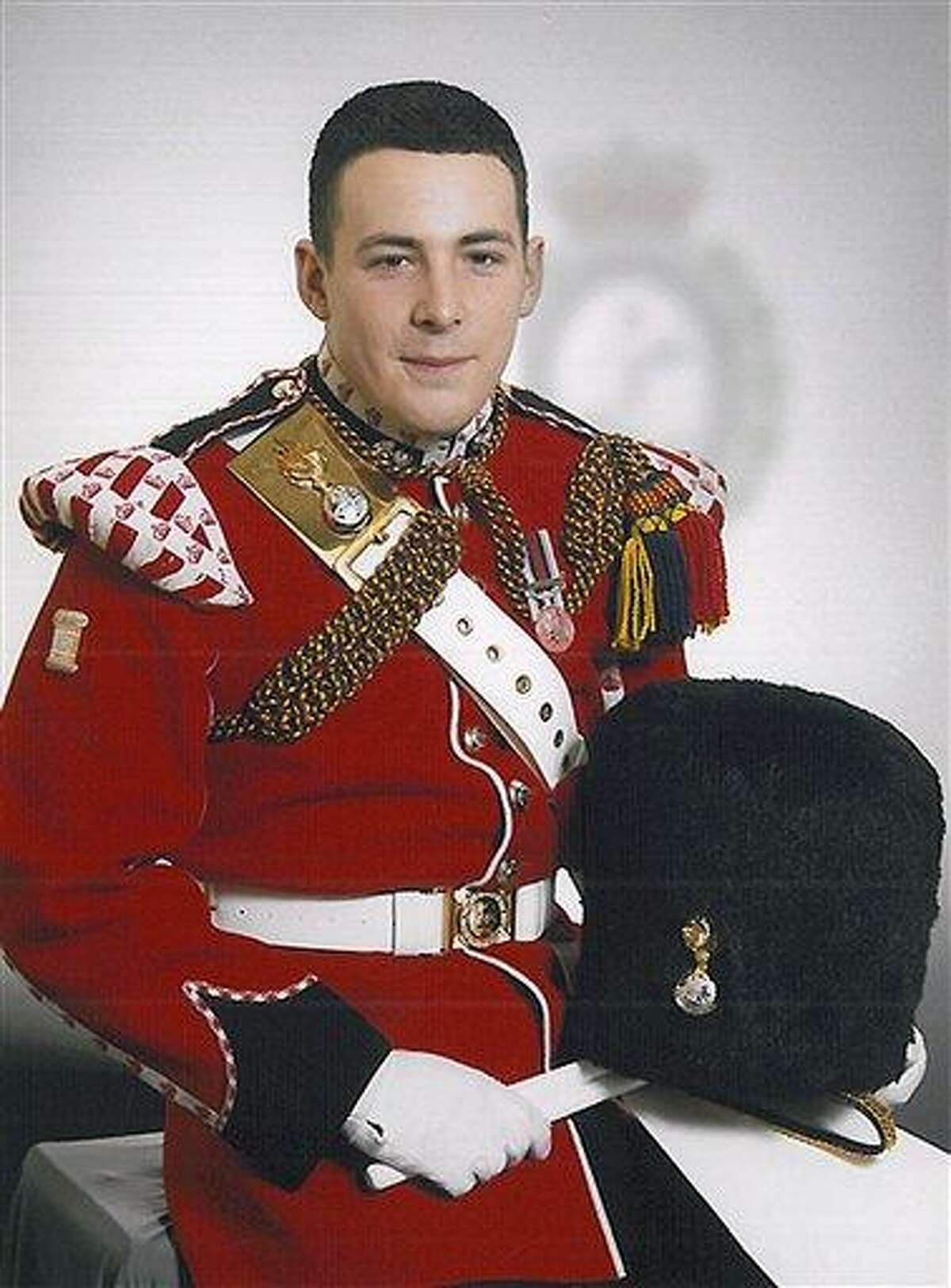 In this undated image released Thursday May 23, 2013, by the British Ministry of Defence, showing Lee Rigby known as 'Riggers' to his friends, who is identified by the MOD as the serving member of the armed forces who was attacked and killed by two men in the Woolwich area of London on Wednesday. The Ministry web site included the statement