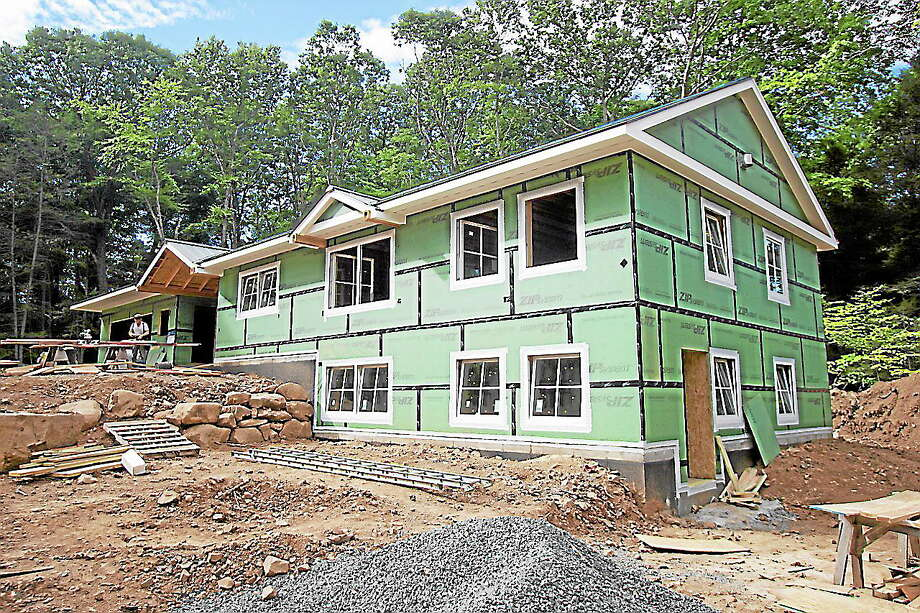 """Submitted photo - WolfworksThis house at 17 Metacomet Road in Farmington, designed by Jamie Wolf of Wolfworks in Avon, is being built as a net zero """"passive house."""" Another tour in Harwinton is set for Saturday, Oct. 5. Photo: Journal Register Co."""