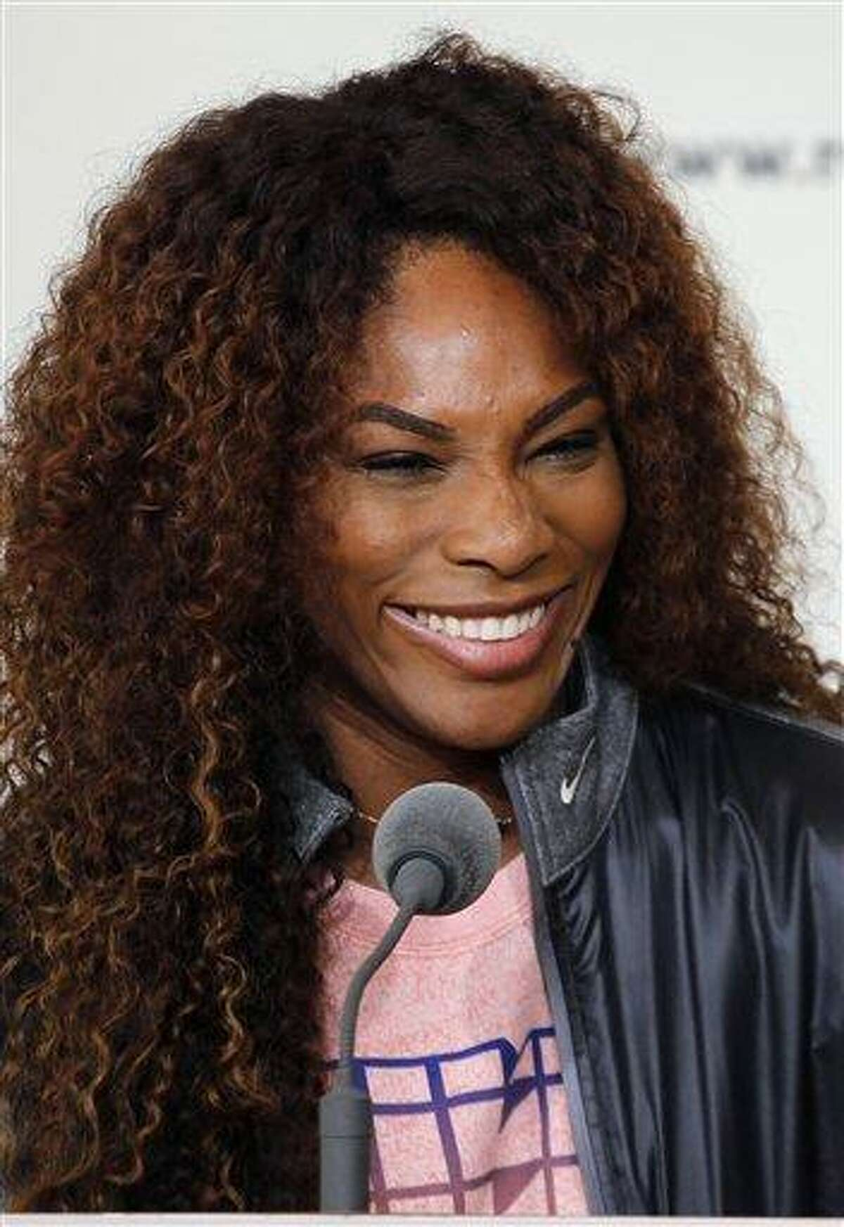 Serena Williams, of the United States smiles during a press conference for the 2013 French Open tennis tournament, at Roland Garros stadium in Paris, Friday May, 24, 2013. (AP Photo/Christophe Ena)