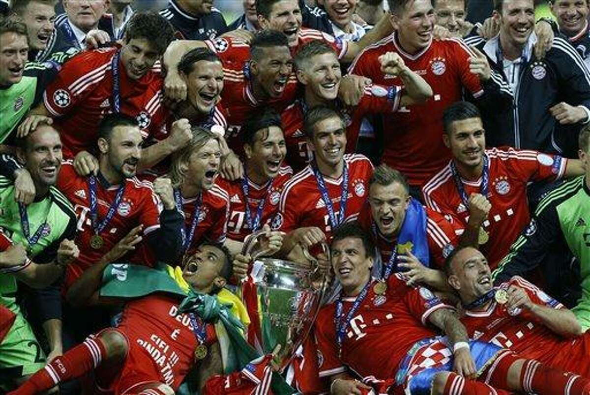 Bayern Munich players celebrate, after winning the Champions League Final against Borussia Dortmund , at Wembley Stadium in London, Saturday May 25, 2013. (AP Photo/Kirsty Wigglesworth)