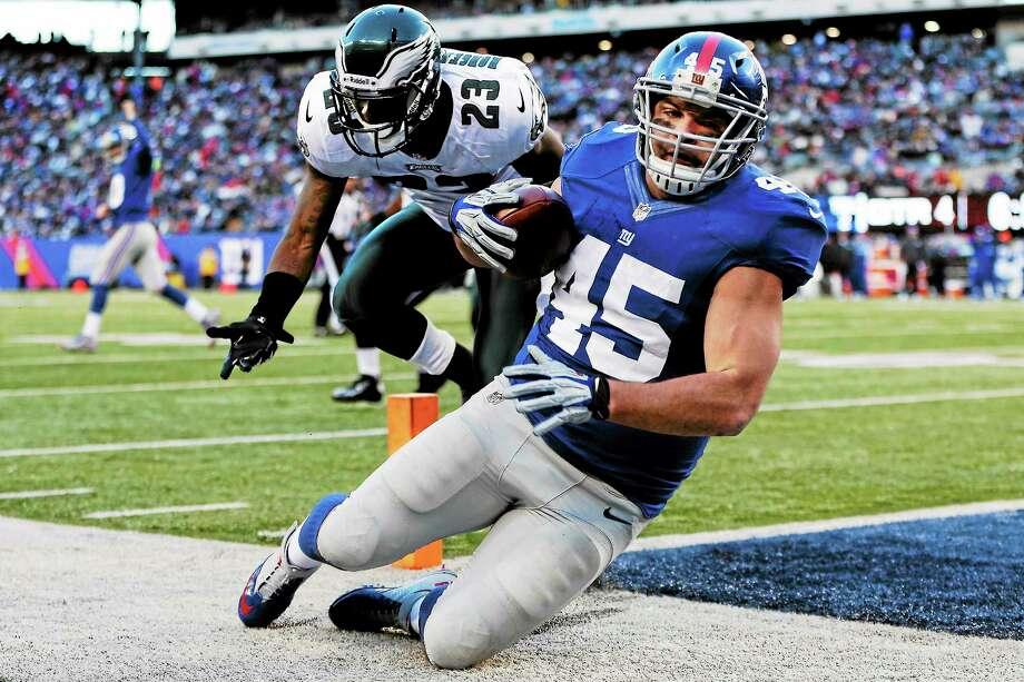 Giants fullback Henry Hynoski catches a pass for a touchdown in a game against the Philadelphia Eagles last season. New York placed Hynoski on the injured reserve list and signed fullback John Conner. Photo: Kathy Willens — The Associated Press  / AP2012
