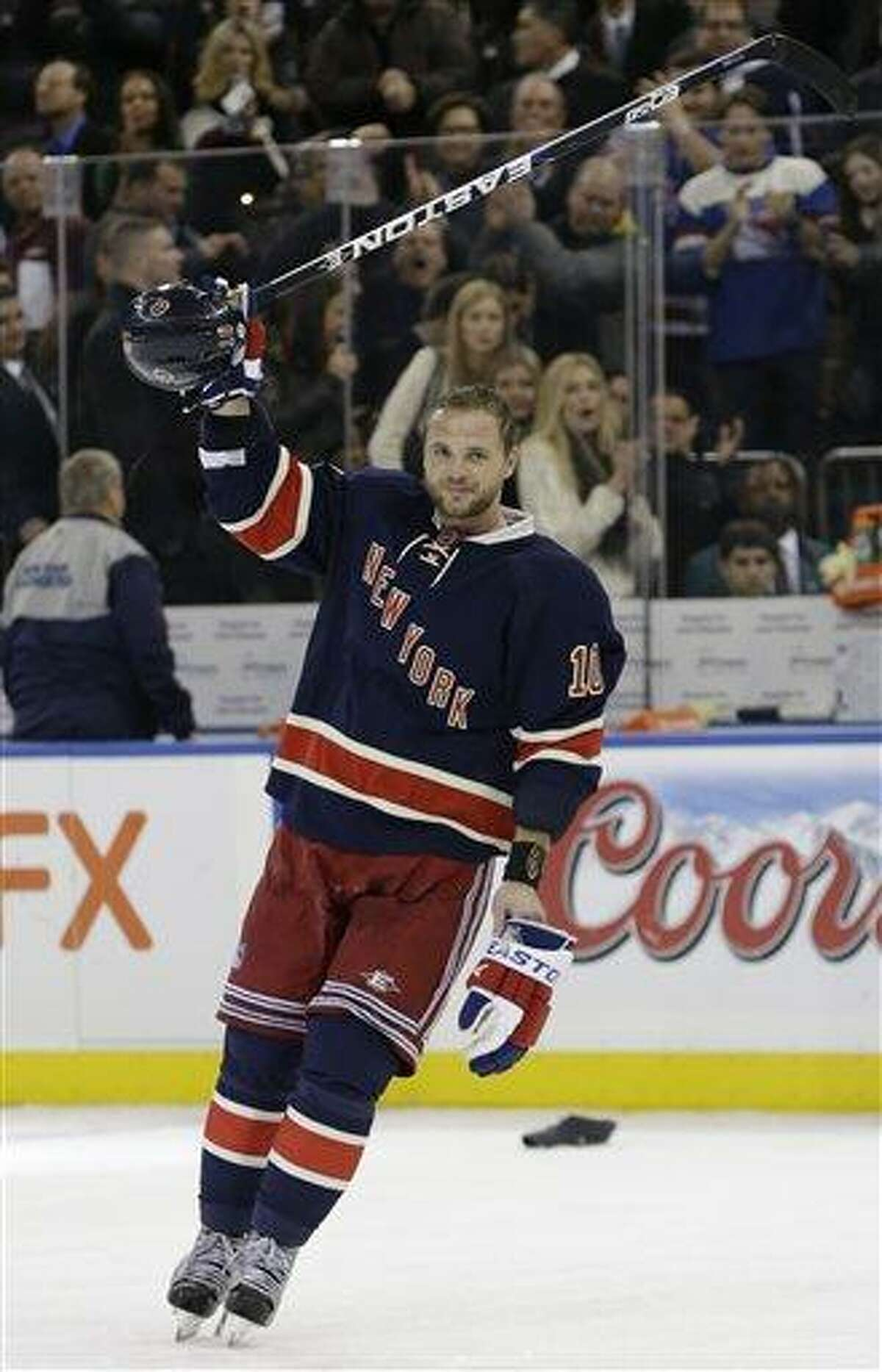 New York Rangers right wing Marian Gaborik (10) acknowledges the crowd after an overtime goal for a hat trick in the Rangers 4-3 overtime victory over the Boston Bruins in an NHL hockey game at Madison Square Garden in New York, Wednesday, Jan. 23, 2013. (AP Photo/Kathy Willens)