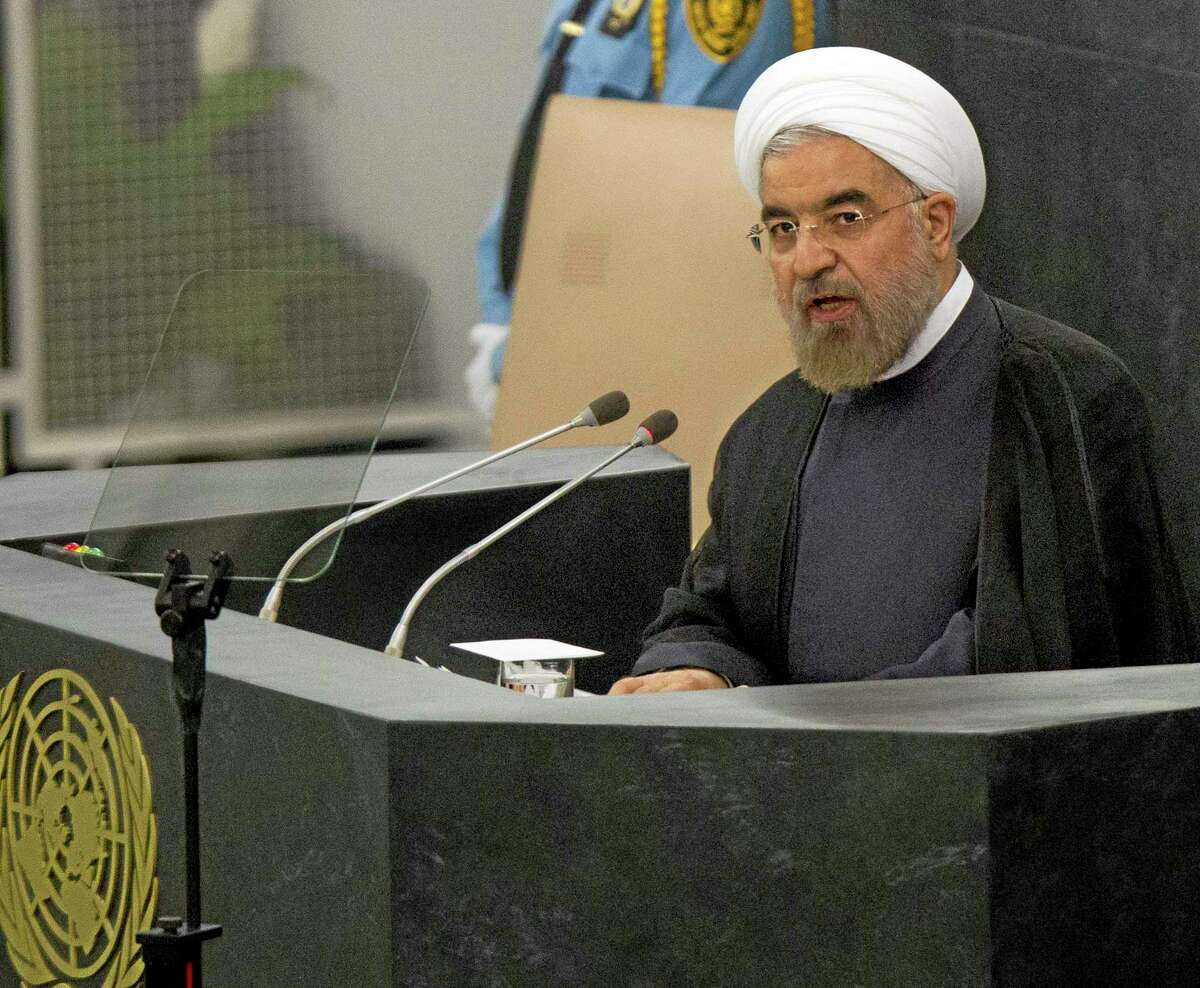 Hasan Rouhani, President of the Islamic Republic of Iran, addresses the 68th United Nations General Assembly at UN headquarters, Tuesday, Sept. 24, 2013. (AP Photo/Brendan McDermid, Pool