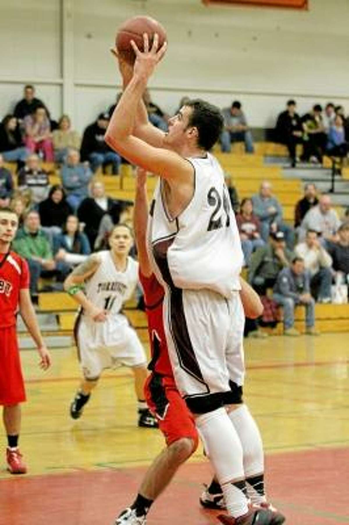 Torrington center Dave Canny takes a shot against Derby. Photo by Marianne Killackey/Special to Register Citzen