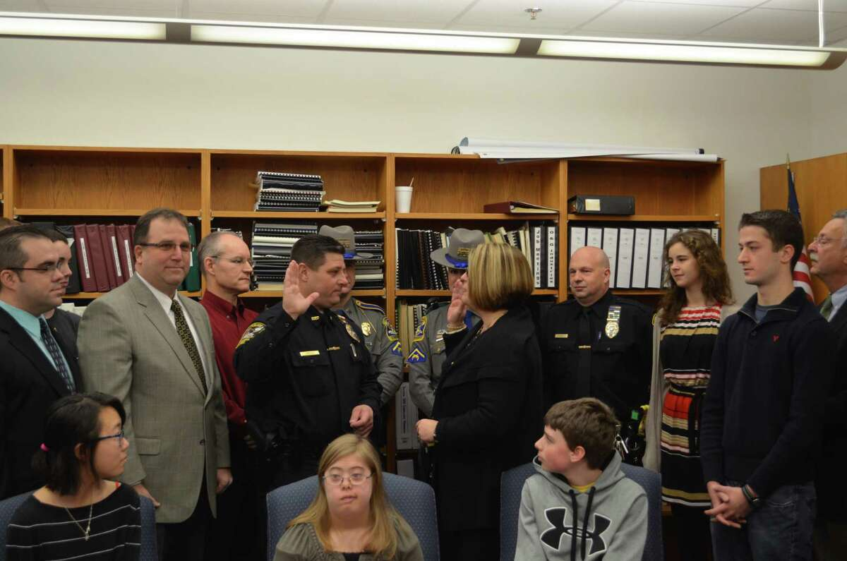 Sarah Bogues/Register Citizen Region 10 officials swear in the district's new school resource officer during a ceremony Tuesday morning.
