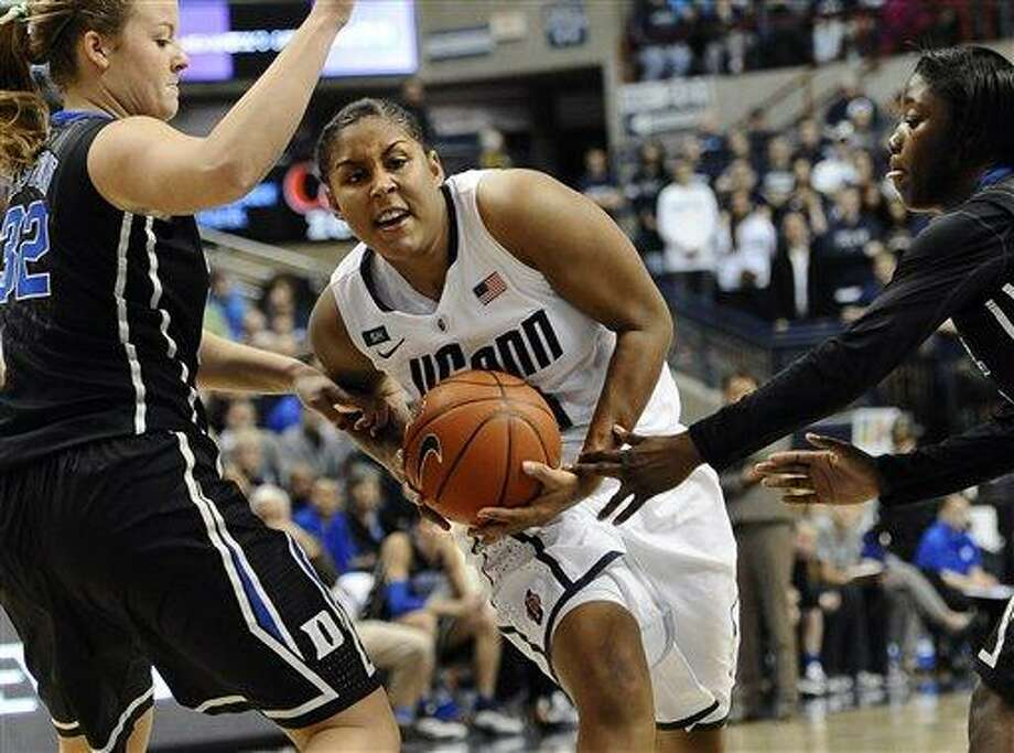 Connecticut's Kaleena Mosqueda-Lewis, center, is pressured by Duke's Tricia Liston, left, and Duke's Alexis Jones, right, during the second half of an NCAA college basketball game in Storrs, Conn., Monday, Jan. 21, 2013. Connecticut won 79-49. (AP Photo/Jessica Hill) Photo: ASSOCIATED PRESS / A2013