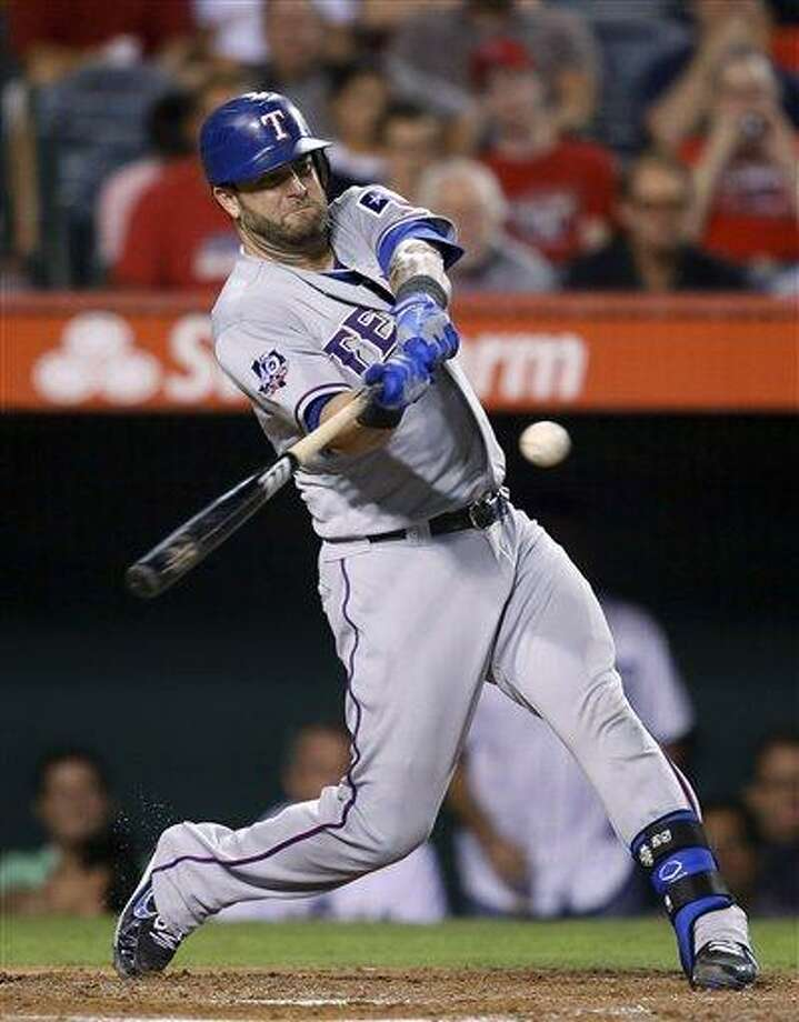Texas Rangers' Mike Napoli hits a home run in the third inning of a baseball game against the Los Angeles Angels in Anaheim, Calif., Tuesday, Sept. 18, 2012. (AP Photo/Jae C. Hong) Photo: ASSOCIATED PRESS / AP2012