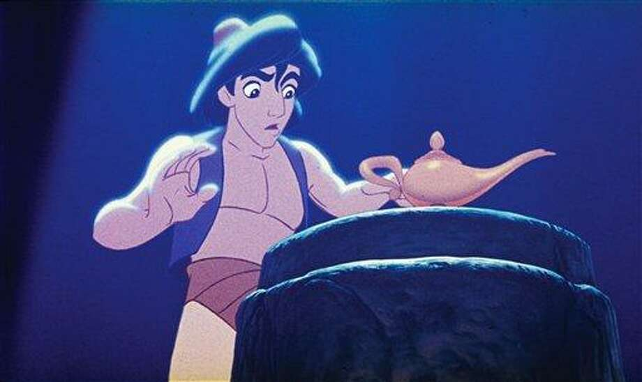 """This undated publicity photo provided by Disney Theatrical Productions shows Aladdin with a lamp in a scene from the 1992 animated film, """"Aladdin."""" A stage musical of """"Aladdin"""" is riding a magic carpet to Broadway and the president of Disney Theatrical Productions promises it will be """"a full-length, big song musical with big dance numbers.""""  Thomas Schumacher said on Friday, Jan. 18, 2013, that the final two-act """"Aladdin"""" will build on the 1992 film blockbuster with new songs by Alan Menken, additional characters and, appropriately, some magic tricks. (AP Photo/Disney Theatrical Productions) Photo: AP / Disney Theatrical Productions"""