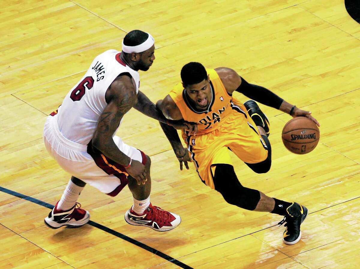 Indiana's Paul George tries to dribble past the Heat's LeBron James during Game 7 in the NBA Eastern Conference finals on June 3 in Miami.