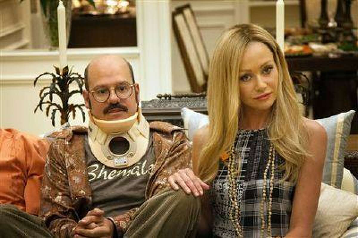 This undated publicity photo released by Netflix shows David Cross, left, and Portia de Rossi in a scene from