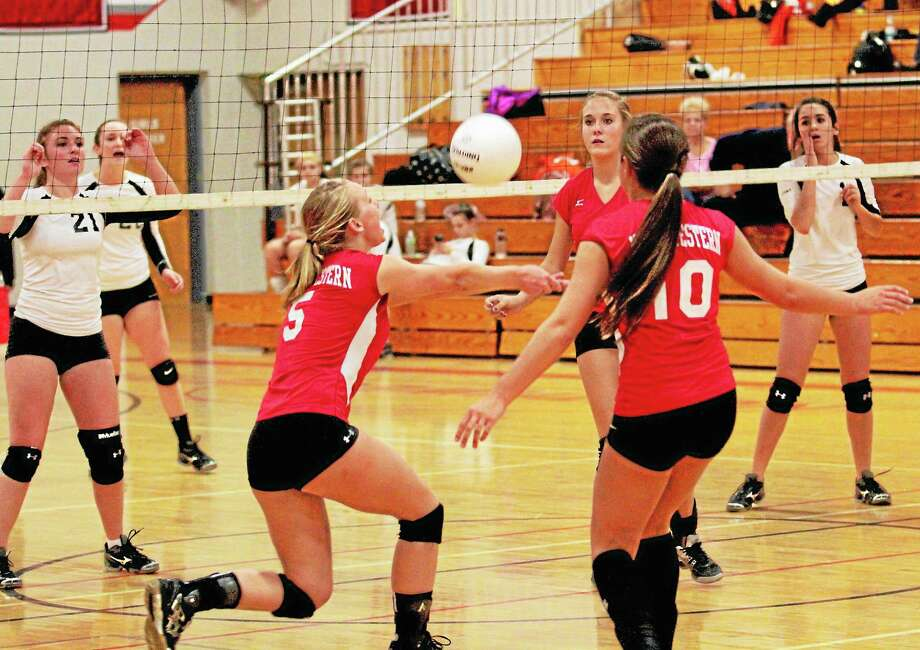 Northwestern's Taylor Fetzer bumps the ball during the Highlanders 3-2 win over Terryville. Fetzer had eight kills, seven digs and six aces in the win. Photo: Marianne Killackey — Special To The Register Citizen  / 2013