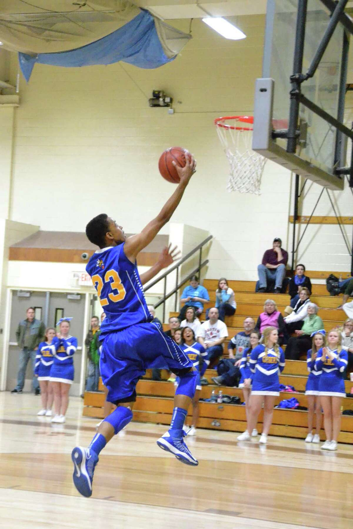Gilbert's Robert Skinner scores two of his game-high 26 points. Pete Paguaga/Register Citizen